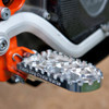 MACHINE FINISH BDCW Platform Footpeg for big BMW adventure bikes. Available in standard or lowered heights, as well as anodized black or orange finishes.