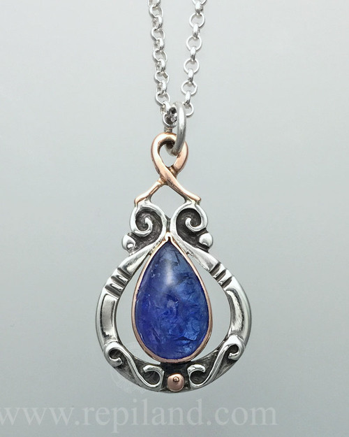 Sterling & rose gold pendant with Tanzanite.