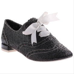 "Irregular Choice Gravitational Pull 2- Black, Black Glittered brogue with 1/2"" heel and white ribbon."