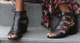 Lifestyle view: Women Shoes Online, Women's Shoes, Women's Sandals, Nicole Tatiana Sandal, Western Sandal with cutouts and fringe tassel, Black Leather.