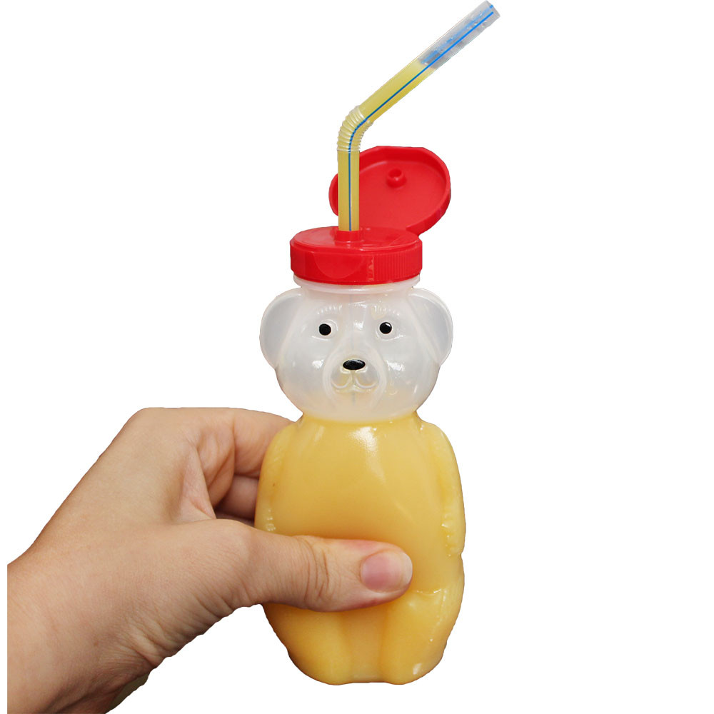 "Squeeze the bear's belly to ""help"" liquid up the straw and to direct the flow"