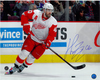 Henrik Zetterberg Autographed Detroit Red Wings 16x20 Photo #1 - Horizontal Skating with Puck
