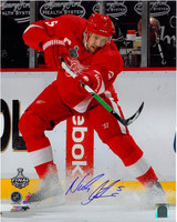 Nicklas Lidstrom Autographed 16x20 Photo #1 - Shooting Puck Ice Spray