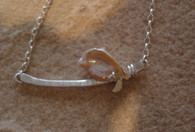 One of a kind fresh water pearl on a silver branch. the necklace is 18 inches .