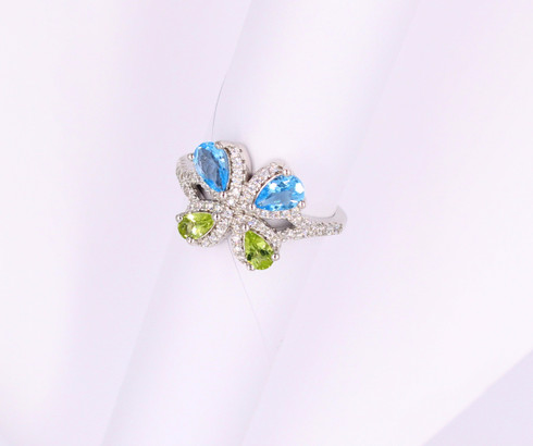 Sterling silver ring with blue topaz, peridot and cz's