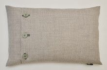 Over view of this fabulous feather filled cushion.  The body is neutral marled wool with gorgeous Seafoam coloured fabric covered buttons, hand stitched on in mid-grey yarn. Usable and diverse size of 60x40cm. Featherfilled insert for added luxury.