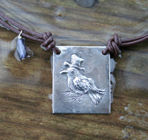 Hand-carved sterling silver crow necklace, with iolite.