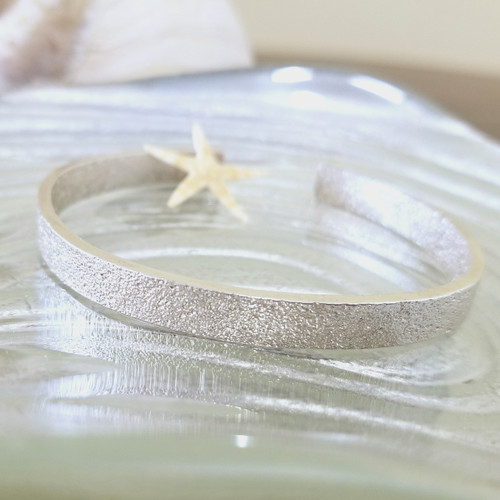 Sterling Silver Cuff Bracelet embossed with sand gathered from the shores of Prince Edward Island.