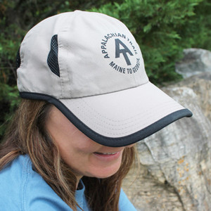 This tan cap comes with black piping and mesh side openings to keep you comfortable all summer long.