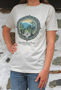 "Compass points encircle a southern Appalachians setting, the trademarked A.T. diamond, and the quote, ""Those who dream the most, do the most."""