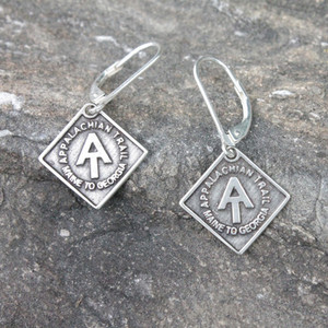 Pair of the  A.T. diamond Trail marker earrings in white bronze.