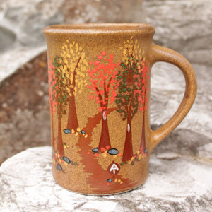 A hand-painted scene of the Appalachian Trail adorns this approximately 10 ounce mug.