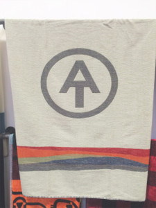 "The A.T. monogram is boldly centered on this 46"" x 60"" wool blanket."