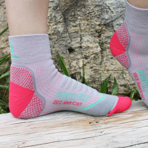 100% American-made of Merino wool reinforced with nylon and spandex with full-density cushioning in the heel and ball.