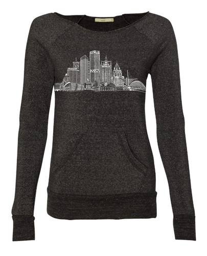 Rock over Milwaukee. Our ode to the city by the lake. Represent! Be proud. And don't wear other Milwaukee schlock. Buildings: US Bank, NML Tower, Mitchell Park Domes, 100 East Building, Art Museum, Eagles Ballroom and the Globe. Allen Bradley, Milwaukee Center, Gas Building, Miller Park, Sydney Hih, MECCA and 411 building. 4.3 oz., 50/46/4 polyester (6.25% recycled)/cotton (6.25% organic)/rayon, 30 singles Low-impact yarn dyed.