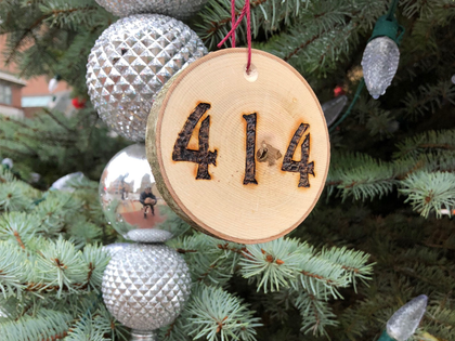 "Hand cut from cherry wood, the 414 Milwaukee ornament will look rad hanging from your Christmas tree for the holidays. City Hall Christmas tree not included with purchase. Finish size 4"" x 3.5"""