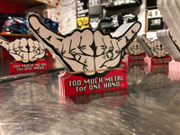 """This is the big Too Much Metal sticker. Show your music love. Bust out the double Too Much Metal horns and salute the independent spirit of rock and roll . 100% Vinyl Outdoor Stock. Size 3"""" x 6"""""""
