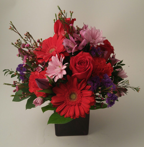 A stunning mix of roses, Gerber daisy's, Alstroemeria, Statice, Carnations,Wax flower,Daisy Poms & Tulips