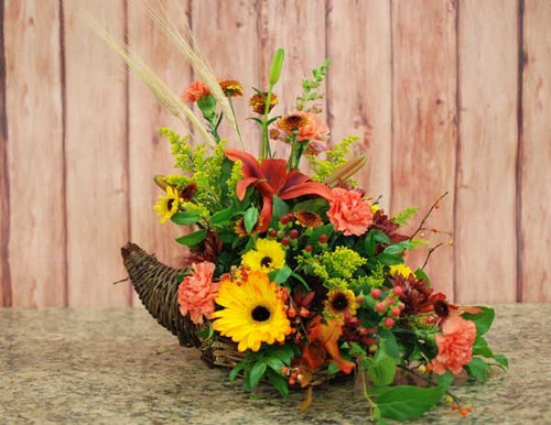 Cornucopia thanksgiving floral centerpiece with fresh seasonal fall flowers