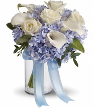 """Blue hydrangea, white callas and roses. Available in other colors  Approximately 10"""" W x 11"""" H"""