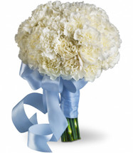 """A lush cluster of bright white carnations held with a blue satin ribbon. Approximately 9"""" W x 12"""" H"""
