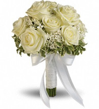 """White roses and bouvardia contrasted by variegated pittosporum. Approximately 9"""" W x 11 1/2"""" H"""