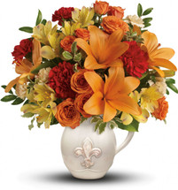 Capture the lovely warmth of summer with this gorgeous arrangement. Orange spray roses and asiatic lilies arrive in our charming French country ceramic pitcher.