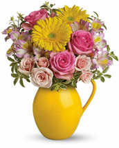 Pour on the charm with this delightfully sunny mix! Arranged in our signature Sunny Day pitcher - a lovely gift - this mix of bright gerberas and delicate roses is a guaranteed smile-getter. Includes pink roses, yellow gerbera daisies and alstroemeria. Delivered in Teleflora's Sunny Day pitcher. Orientation: One-Sided