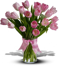 "Beautiful and ""simply said"" light pink tulips are a hip way to show you care. Twenty delicate light pink Tulips arranged in a clear glass vase. Orientation: All-Around"