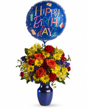 Up, up and away! Take that special someone's birthday to new heights with this happy arrangement and mylar balloon. Bold primary colors and a deep blue vase make it a great pick for sending birthday cheer to men. Flowers including roses, daisies, statice and carnations are mixed in bold tones of yellow, red, orange and purple. Presented in a deep blue glass vase with a mylar balloon. Orientation: All-Around