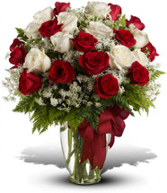 "14 Red and 10 white roses accented with Queen Anne's lace and more are delivered in a glass vase accented with a red satin ribbon. Approximately 18 1/2"" W x 23 1/2"" H"