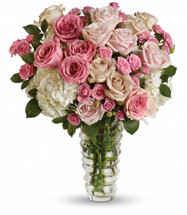 "Remember the song ""Luck Be a Lady"" from Guys and Dolls? Well, if you're a guy and you've got a special doll, this gorgeous bouquet of roses in myriad colors is sure to bring you luck in the love department. You'll see."