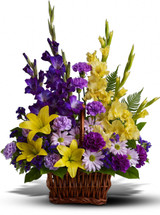 Honor rich remembrances of one dearly missed with a vivid mix of blooms that offer strength and comfort alike during a time of sorrow.