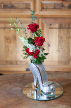 "6 3/4"" Tall Red/Silver Hi Heel Shoe vase with Orchids and Roses"