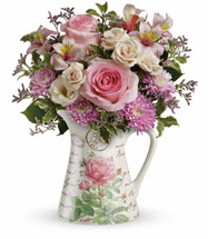 Pretty as a pitcher! Honor her this Mother's Day with a two-in-one gift she's sure to treasure. This decadent bouquet of roses and alstroemeria will fill her heart with love, when delivered in this exclusive, French country pitcher!