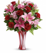 Romance is an art. Perfect it this Valentine's Day with this dramatic take on the classic red rose bouquet! Rich red roses, pretty pink lilies and delicate alstroemeria are masterfully arranged in a stunning glass vase she'll treasure forever.