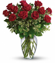 """Say Happy Valentine's Day by sending this lovely arrangement of twelve radiant red roses and fresh greens delivered in a beautiful spring garden vase. Love always. Approximately 20"""" W x 24"""""""