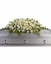 """The peaceful purity of this all white casket spray is a touching, inspiring way to honor the departed. Large in scale, the lush arrangement is ideal for a full couch or closed casket service, featuring elegant white blooms such as calla lilies, dendrobium orchids and hydrangea. White roses, orchids, large calla lilies and perfect stems of hydrangea. Approximately 47"""" W x 17"""" H."""