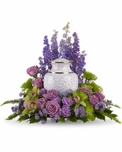 As you come together to share your memories, these assorted purple flowers cradle the urn in a loving embrace. The soft greens and soothing purples are ideal to grace a memorial service. Includes lovely flowers such as lavender larkspur, roses, carnations and asters, plus, green cymbidium orchids and fuji chrysanthemums.Please note: Arrangement does not include urn. Orientation: One-Sided