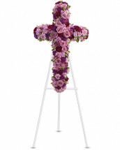 A breathtaking standing cross of majestic purple and lavender blooms remembers and honors the departed with a meaningful and moving expression of faith, admiration and divine love. Gorgeous blooms such as lavender roses and carnations, and chrysanthemums of lavender and deep purple create a religious display ideal for a funeral or memorial service. Orientation: One-Sided
