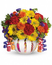 Birthday wishes can come true even before the cake is served when you send this brilliant arrangement! Bright flowers fill a frosted glass bowl that's adorned with a shiny birthday candle motif. It makes a beautiful party centerpiece and a thoughtful gift! Pretty orange spray roses, red miniature carnations, yellow daisy spray chrysanthemums, purple statice and more are joined by yards of curling ribbon and delivered in a very special keepsake container. Brilliant? You bet!