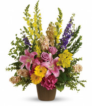 Celebrate the spirit of a loved one who is no longer with us with a gorgeous array of roses, lilies and other favorites.