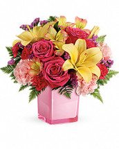 Pop go the petals! This festive, fun-loving mix of flowers is a cheerful gift for any occasion. Hand-delivered in our exclusive Color Splash cube, these pink roses and bright peach lilies are guaranteed to please! This fresh, fun mix of pink roses, peach asiatic lilies, peach alstroemeria, pink carnations and pink miniature carnations is accented with raspberry sinuata statice and leatherleaf fern. Delivered in Teleflora's Color Splash cube. Orientation: One-Sided