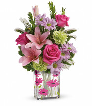 Surprise them with a garden of gratitude! This cheerful mix of pink, green and lavender blooms is presented in a darling daisy vase to brighten up their space - and bring a smile to their face!
