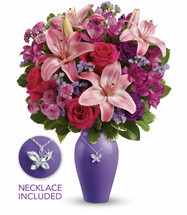 "This beautiful bouquet blends hot pink roses, pink asiatic lilies, purple alstroemeria, purple carnations, purple button spray chrysanthemums and lavender sinuata statice with fresh green pittosporum and lemon leaf. Delivered in a Beautiful Butterfly vase with butterfly charm and silver-plated chain. Approximately 14 1/2"" W x 19 1/4"" H"