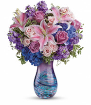 She is nothing short of magnificent! Honor her on Mother's Day with this magical array of lilies, roses, hydrangea and stock. This truly gorgeous bouquet is hand-delivered in a breathtaking swirling art-glass vase crafted in the tradition of fine Venetian glass. It's a grand gesture that she'll never forget!