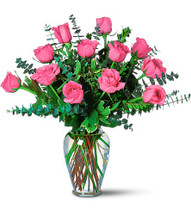 "Surprise someone with these pretty pink roses, and they'll marvel at your great taste. A dozen pink roses with eucalyptus arrive in a beautiful glass vase. Approximately 21-1/2"" W x 20-1/2"" H"