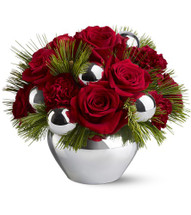 "Red roses and burgundy carnations – accented with evergreens and silver ornament balls – are delivered in a silver-toned jardiniere. Approximately 11"" (W) x 8.5"" (H)"
