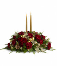 The lush arrangement includes dark red spray roses, maroon carnations, green rhamnus, cedar, fern and oregonia accented with gold pinecones, ornament balls and ribbon. Includes two 12 gold candles. Approximately 22 1/2 W x 16 H
