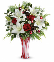 Wow them with roses, snow white lilies and fresh white pine arranged in an elegant and unique art glass vase.